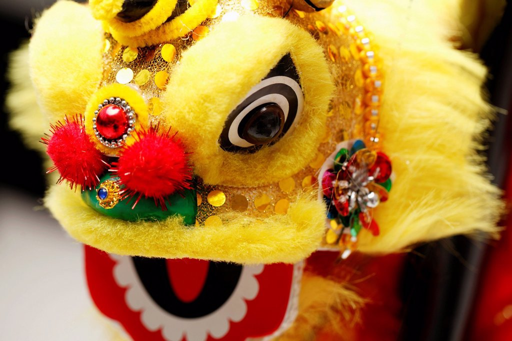 Yellow lion dance toy. Chinese New Year decoration : Stock Photo