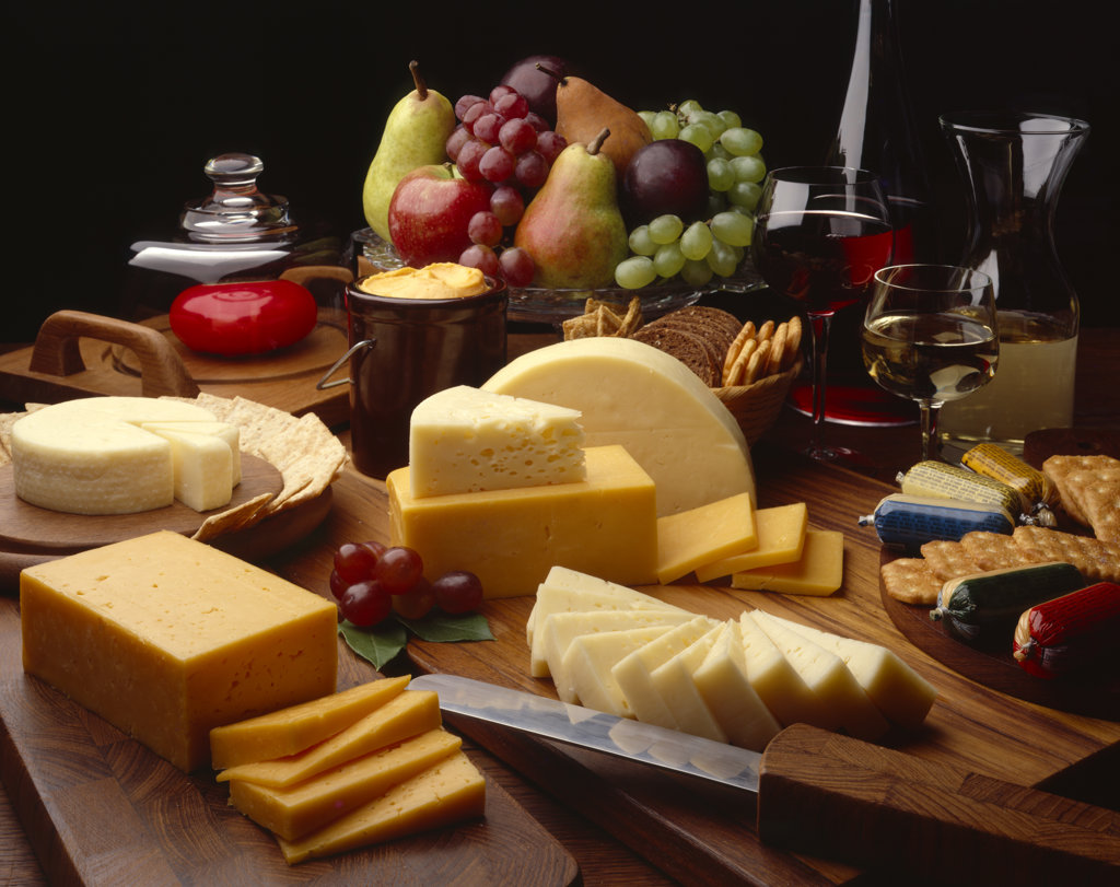 Assorted cheese with fruits and wines : Stock Photo
