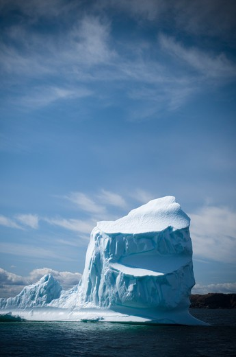 Iceberg and Rocky Coast  : Stock Photo