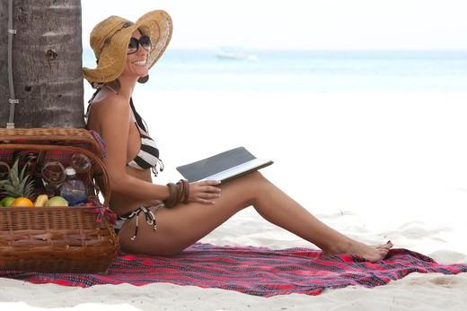 Smiling Woman With Electronic Book on Beach, Aruba : Stock Photo