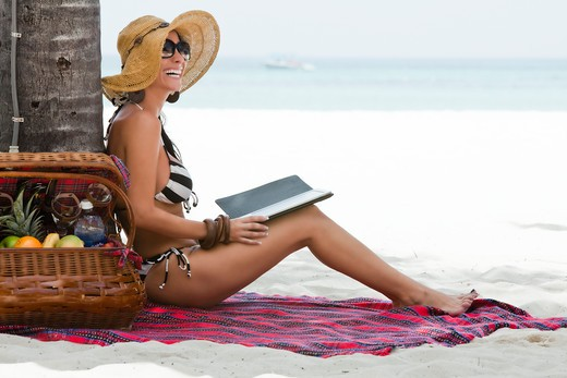 Smiling Woman With Electronic Book on Beach, Aruba : Stock Photo