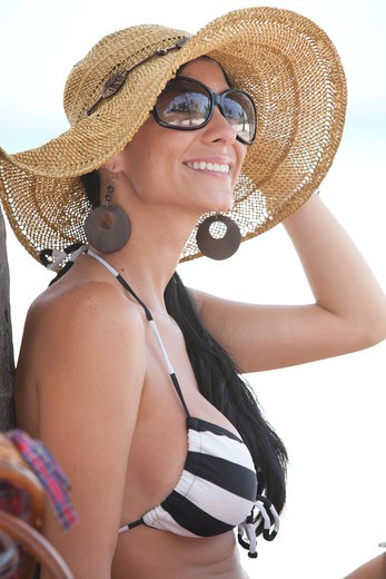 Smiling Woman Wearing Sunglasses and Floppy Hat on Beach, Portrait, Aruba : Stock Photo