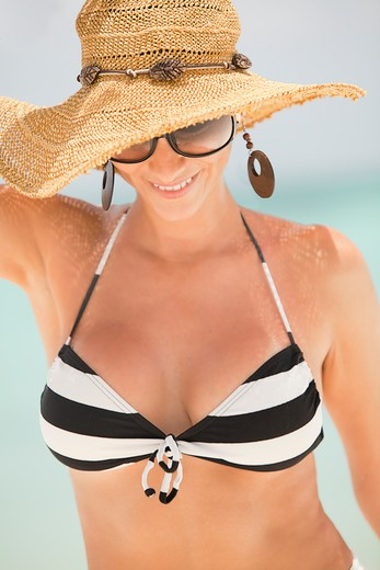 Smiling Woman in Bikini and Floppy Hat on Beach, Aruba : Stock Photo