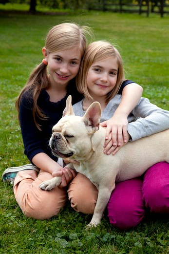 Two Smiling Girls With Dog : Stock Photo