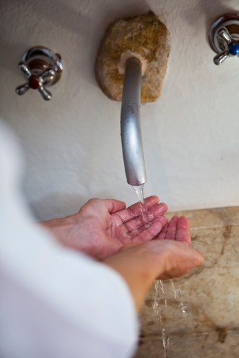 Stock Photo: 4089R-337 Woman washing hands in sink
