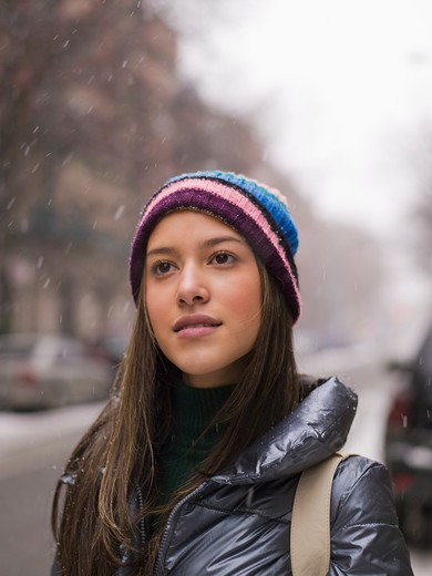 Close-up of a teenage girl in snowing, New York City, New York State, USA : Stock Photo