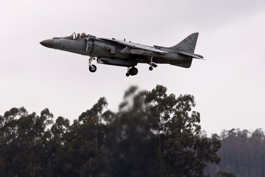 Stock Photo: 4093-10046 A Marine Corps AV-8B Harrier from MAG 13 doing an aerial demonstration at the Watsonville, CA airshow. The McDonnell Douglas AV-8B Harrier II is a family of second-generation vertical/short takeoff and landing or V/STOL ground-attack aircraft of the late 20th century. It is primarily used for light attack or multi-role tasks, typically operated from small aircraft carriers and large amphibious assault ships.