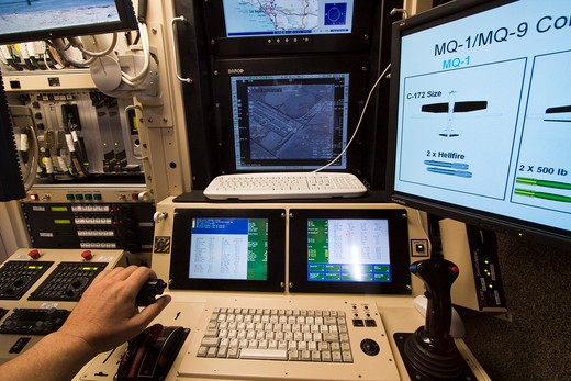 Stock Photo: 4093-10083 Interior view of the Ground Control Station for the General Atomics MQ-1 Predator. The Predator is an unmanned aerial vehicle (UAV) which the United States Air Force describes as a MALE (medium-altitude, long-endurance) UAV system. It can serve in a reconnaissance role and fire two AGM-114 Hellfire missiles. The aircraft, in use since 1995, has seen combat over many regions of the world. It is a remote-controlled aircraft.  The MQ-1 Predator is a system, not just an aircraft. The fully operati