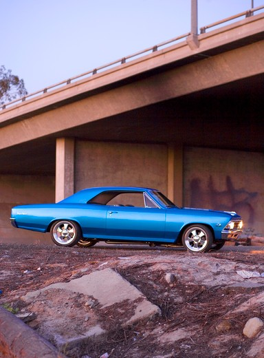 1966 Chevrolet Chevelle Blue near train tracks : Stock Photo