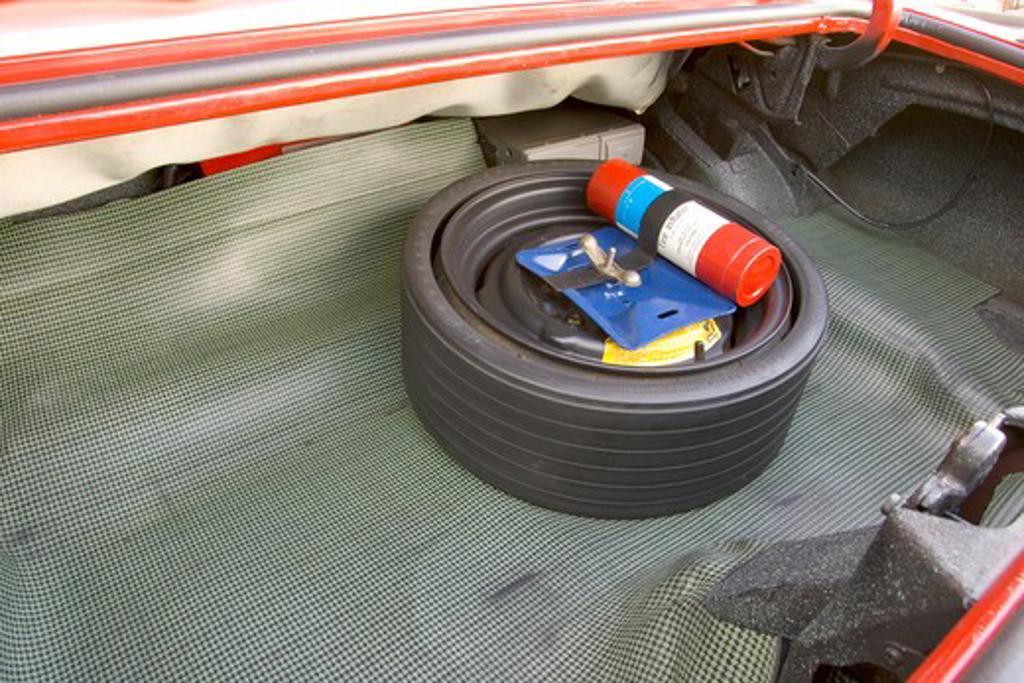 1967 Pontiac Firebird Convertible trunk spare tire : Stock Photo