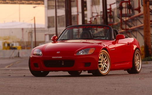 Stock Photo: 4093-10756 2004 Honda s2000 s-2000 Neuspeed  S2000 features a front-mid-engine, rear wheel drive layout with power being delivered via a Torsen limited slip differential mated to a six-speed manual transmission.  The S2000 comes with an electrically powered cloth top, and an OEM hardtop is also available.  The 2004 model introduced newly designed 17 wheels and Bridgestone RE-050 tires along with a retuned suspension that reduced the car's tendency to oversteer. The spring rates and shock absorber damping w