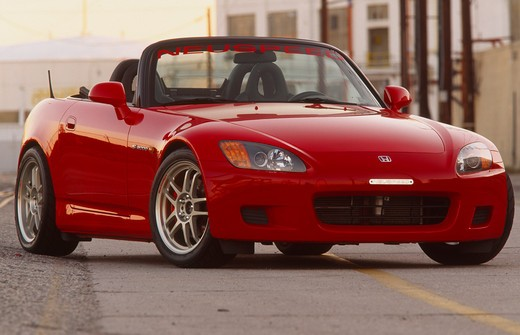 Stock Photo: 4093-10757 2004 Honda s2000 s-2000 Neuspeed  S2000 features a front-mid-engine, rear wheel drive layout with power being delivered via a Torsen limited slip differential mated to a six-speed manual transmission.  The S2000 comes with an electrically powered cloth top, and an OEM hardtop is also available.  The 2004 model introduced newly designed 17 wheels and Bridgestone RE-050 tires along with a retuned suspension that reduced the car's tendency to oversteer. The spring rates and shock absorber damping w