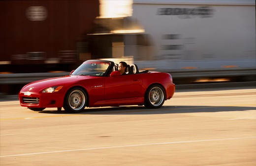 2004 Honda s2000 s-2000 Neuspeed  S2000 features a front-mid-engine, rear wheel drive layout with power being delivered via a Torsen limited slip differential mated to a six-speed manual transmission.  The S2000 comes with an electrically powered cloth top, and an OEM hardtop is also available.  The 2004 model introduced newly designed 17 wheels and Bridgestone RE-050 tires along with a retuned suspension that reduced the car's tendency to oversteer. The spring rates and shock absorber damping w : Stock Photo