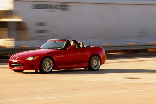 Stock Photo: 4093-10760 2004 Honda s2000 s-2000 Neuspeed  S2000 features a front-mid-engine, rear wheel drive layout with power being delivered via a Torsen limited slip differential mated to a six-speed manual transmission.  The S2000 comes with an electrically powered cloth top, and an OEM hardtop is also available.  The 2004 model introduced newly designed 17 wheels and Bridgestone RE-050 tires along with a retuned suspension that reduced the car's tendency to oversteer. The spring rates and shock absorber damping w
