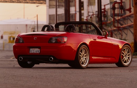 Stock Photo: 4093-10761 2004 Honda s2000 s-2000 Neuspeed  S2000 features a front-mid-engine, rear wheel drive layout with power being delivered via a Torsen limited slip differential mated to a six-speed manual transmission.  The S2000 comes with an electrically powered cloth top, and an OEM hardtop is also available.  The 2004 model introduced newly designed 17 wheels and Bridgestone RE-050 tires along with a retuned suspension that reduced the car's tendency to oversteer. The spring rates and shock absorber damping w