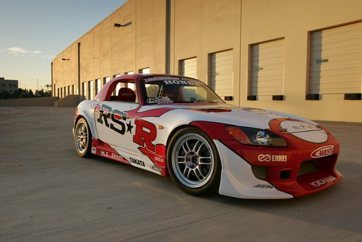 2004 Honda s2000 s-2000 Hardtop racing version race type   S2000 features a front-mid-engine, rear wheel drive layout with power being delivered via a Torsen limited slip differential mated to a six-speed manual transmission.  The S2000 comes with an electrically powered cloth top, and an OEM hardtop is also available.  The 2004 model introduced newly designed 17 wheels and Bridgestone RE-050 tires along with a retuned suspension that reduced the car's tendency to oversteer. The spring rates and : Stock Photo