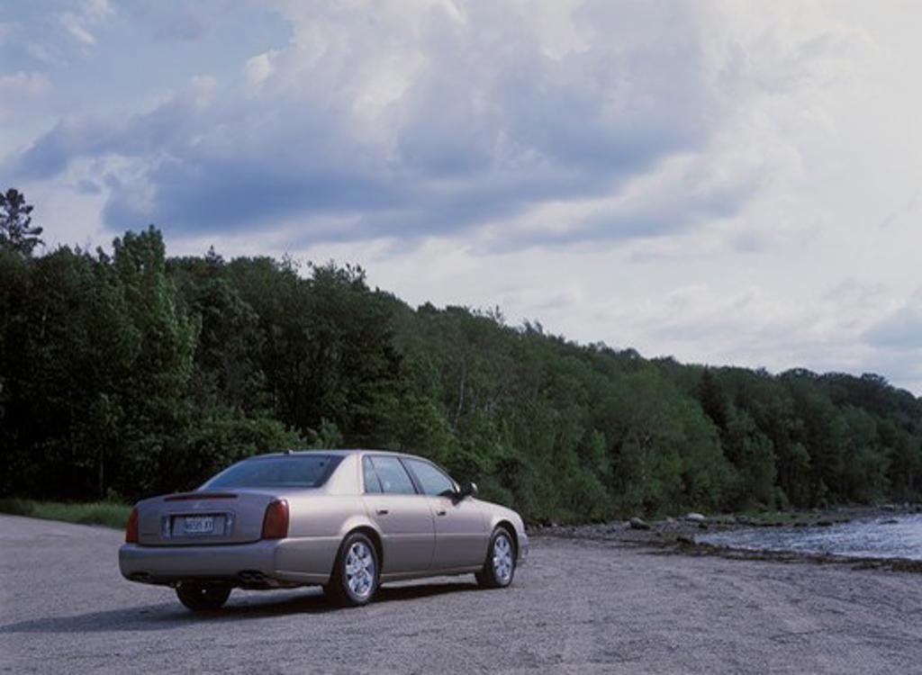 Stock Photo: 4093-10972 Cadillac DeVille DTS 2003 silver shore beach bank