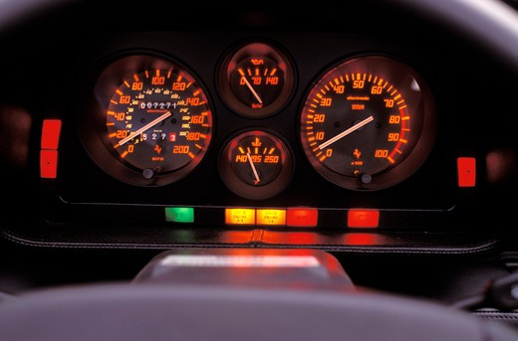 Stock Photo: 4093-11849 interior Ferrari 1993 348 Spider detail gauges speedometer odometer tachometer fuel gauge check engine light temperature 1990s