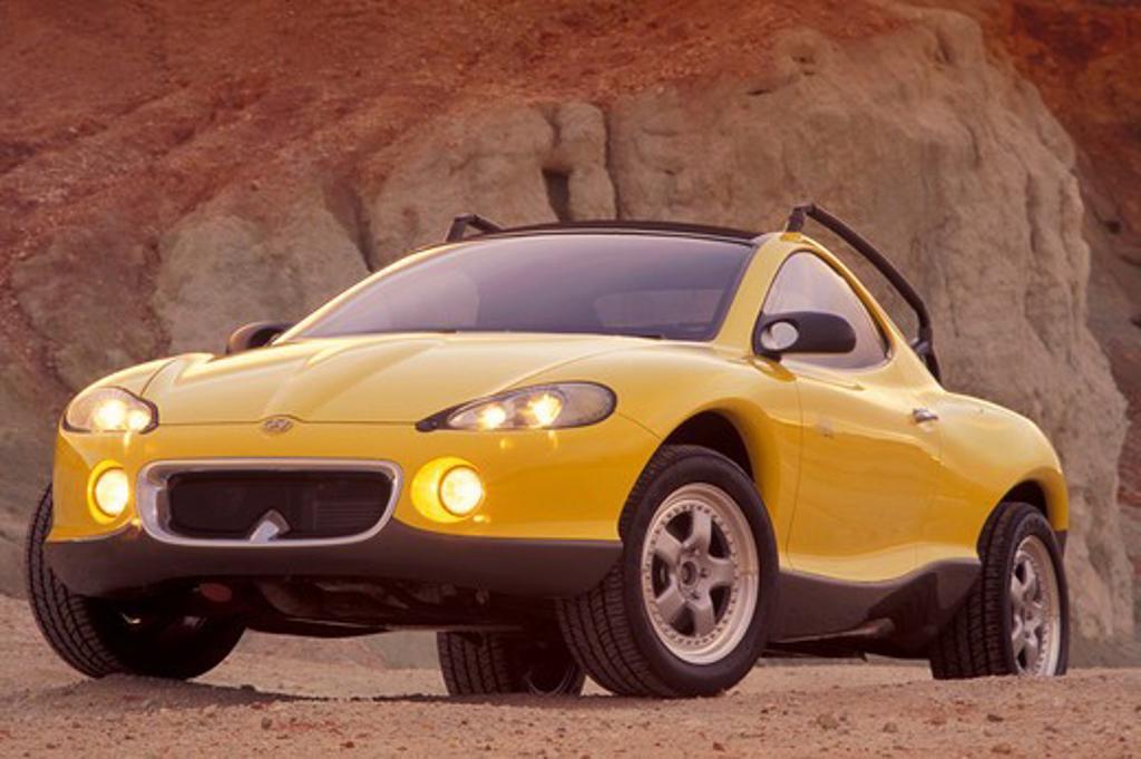 Stock Photo: 4093-11927 Hyundai HCDIII concept show car prototype yellow front 3/4 beauty off-road headlights
