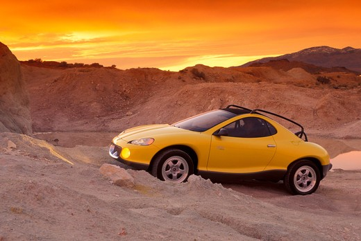 Hyundai HCDIII concept show car prototype yellow profile beauty off-road headlights man rocks street : Stock Photo