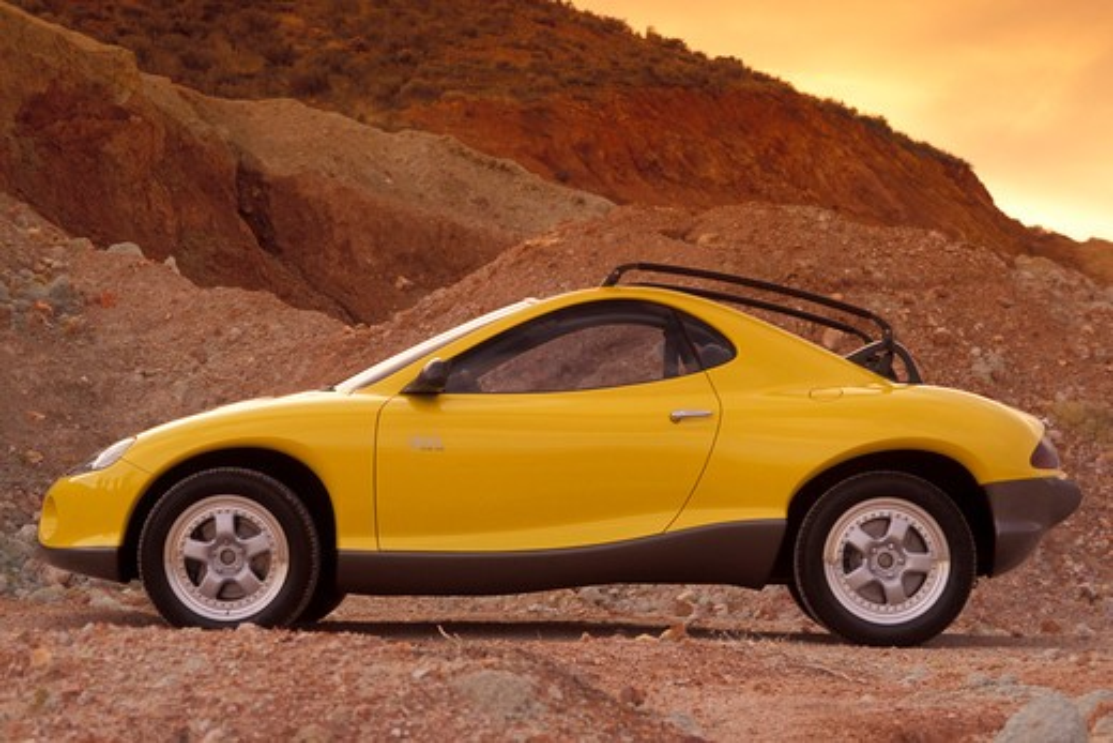 Hyundai HCDIII concept show car prototype yellow profile beauty off-road rocks : Stock Photo