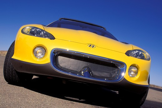 Stock Photo: 4093-11931 Hyundai HCDIII concept show car prototype yellow front nose beauty asphalt pavement head on street