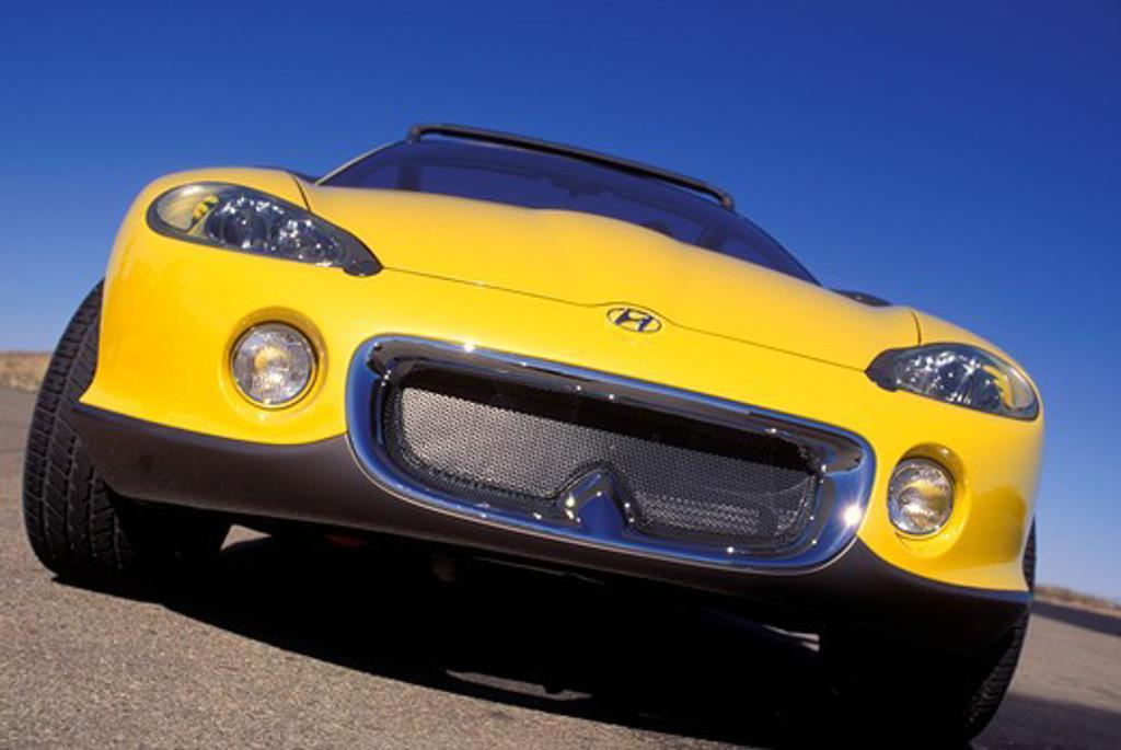 Hyundai HCDIII concept show car prototype yellow front nose beauty asphalt pavement head on street : Stock Photo