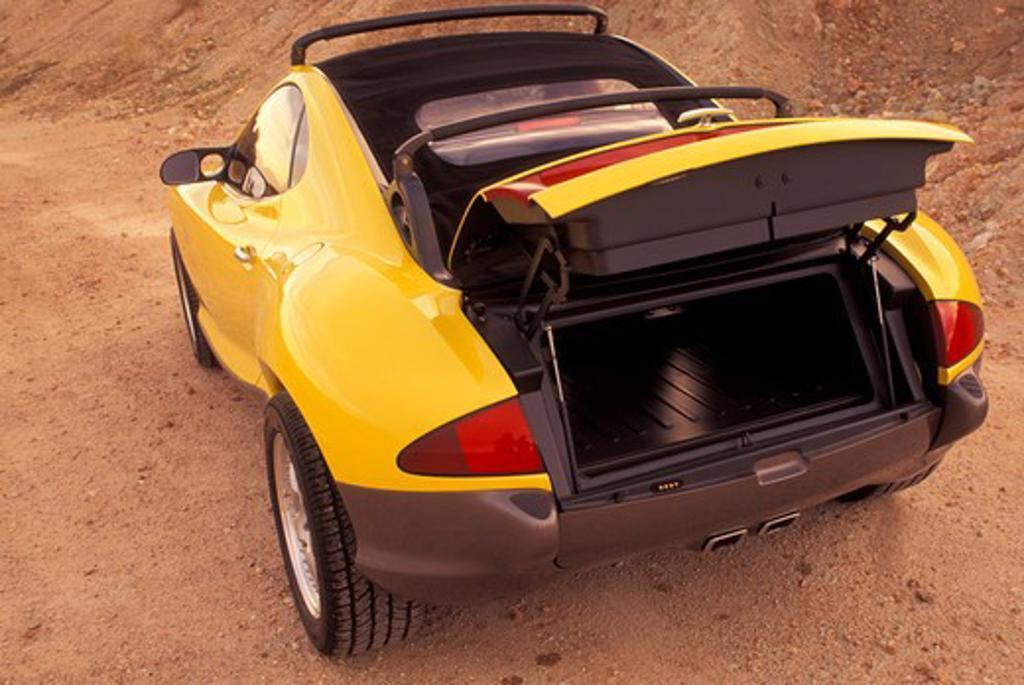 Stock Photo: 4093-11932 Hyundai HCDIII concept show car prototype yellow rear 3/4 off-road open trunk