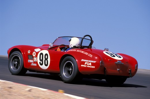 Shelby Cobra 427 1965 #98 Bob Bondurant driver red 1960s race car street : Stock Photo