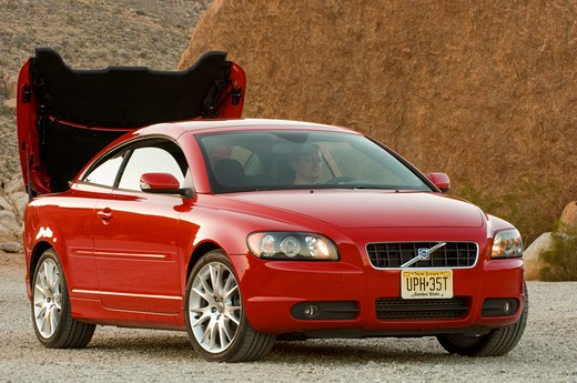 2007 red Volvo C70 with retractable hardtop. Considered both a Convertible and a Coupe. : Stock Photo
