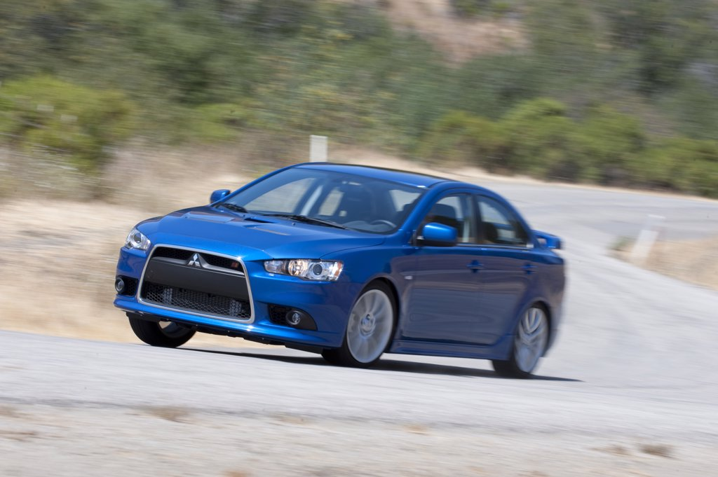 2009 Mitsubishi Lancer Rallyart Sport Sedan on an empty road in central California : Stock Photo