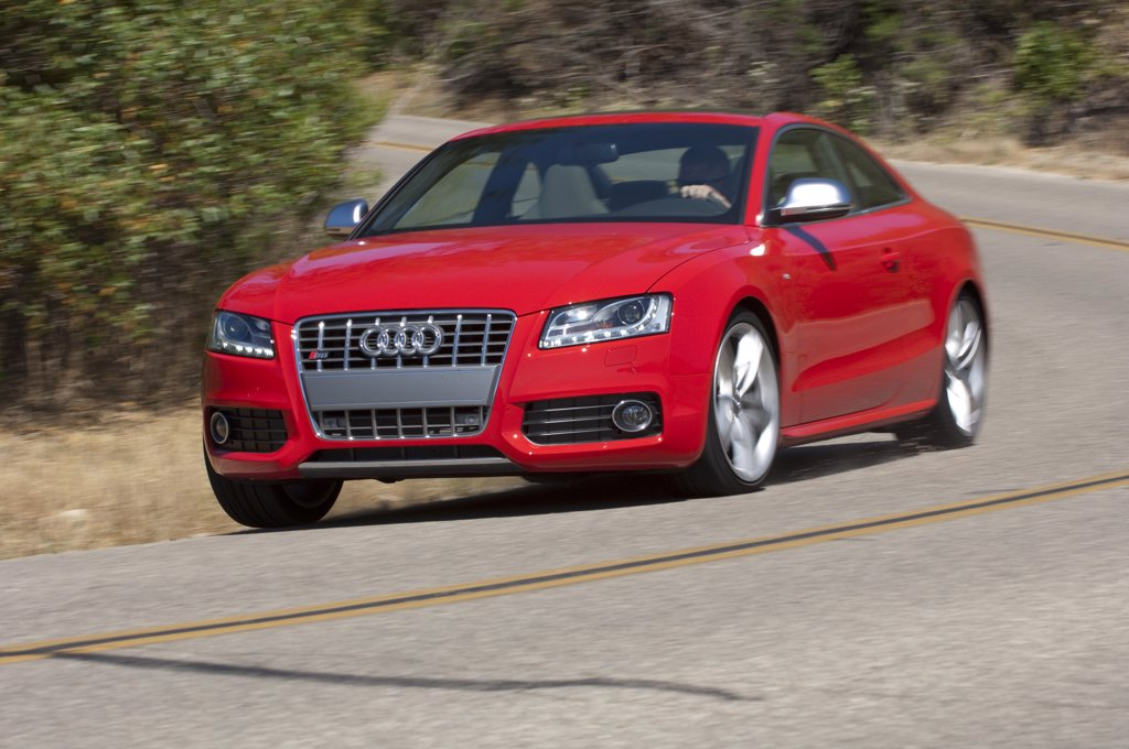 2008 Audi S5 4.2 L Fuel Stratified Injection (FSI) V8 engine, producing 349 hp driving the coast : Stock Photo