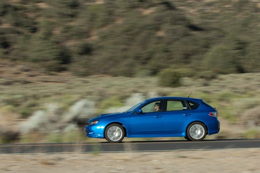 Stock Photo: 4093-14225 Subaru Impreza WRX driving along road, side view
