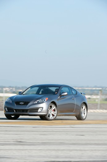 2010 Hyundai Genesis Coupe 2.0T front 3/4 on road : Stock Photo