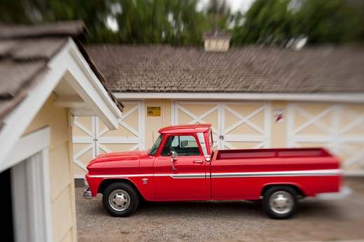 Stock Photo: 4093-14589 1964 Chevrolet K20 Truck stationary by garage, side view
