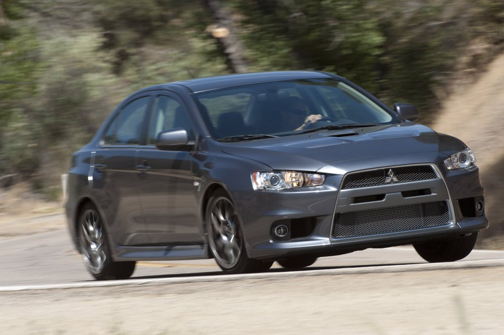 2010 Mitsubishi EVO MR on curved road, front 3/4 : Stock Photo