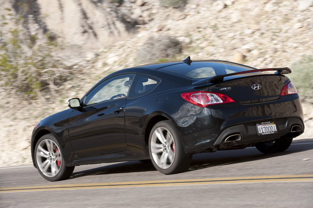 Stock Photo: 4093-14711 2010 Hyundai Genesis Coupe 3.8 V-6 on the road, rear 7/8