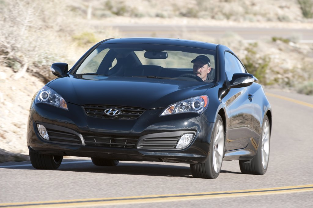 2010 Hyundai Genesis Coupe 3.8 V-6 on road front 3/4 : Stock Photo