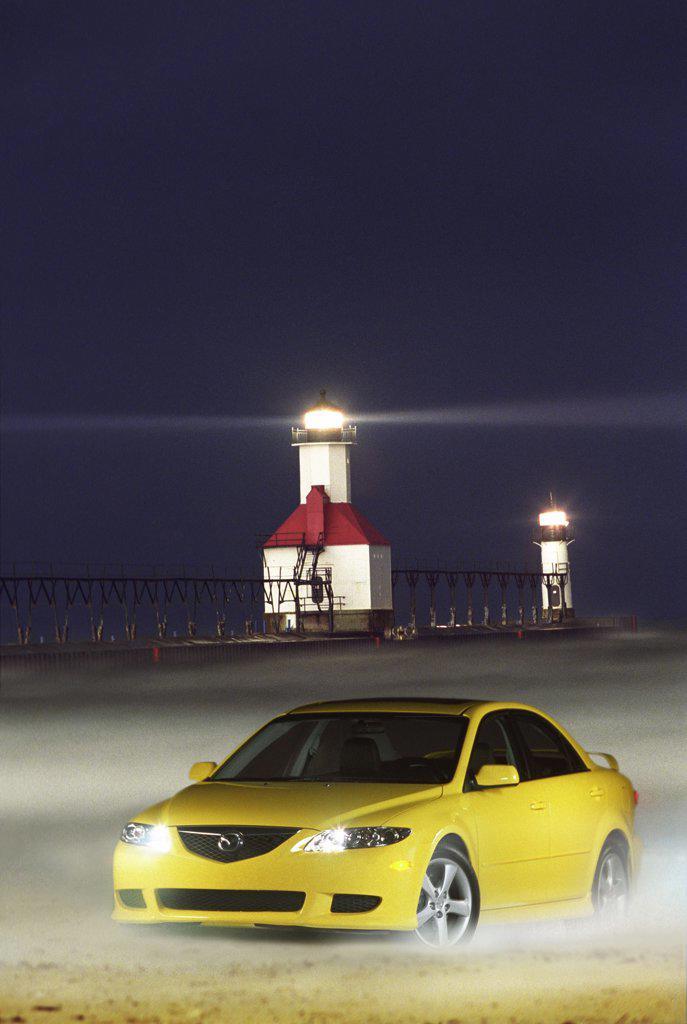 6 Mazda6 2003 yellow lighthouse pier sand beach : Stock Photo