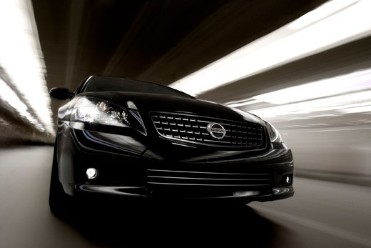 low angle Nissan Altima SE-R 2005 black lights streaks : Stock Photo