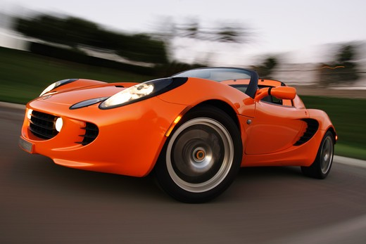 low angle Lotus Elise 2005 orange wheel headlight scoops : Stock Photo