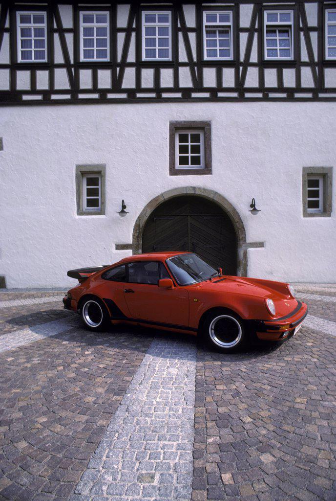 Porsche 911 Turbo 3.3 1988 red plaza 1980s : Stock Photo