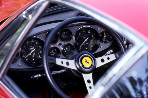 detail Ferrari 365 GTB/4 Daytona 1971 1970s red window steering wheel gauges tachometer speedometer : Stock Photo