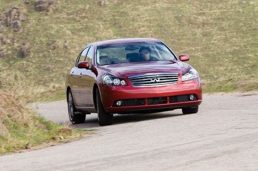Infiniti M45 2006 red cornering handling : Stock Photo