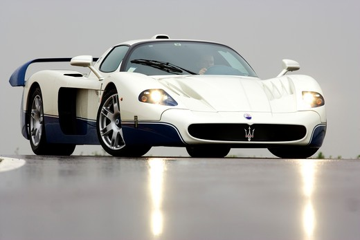Stock Photo: 4093-16572 Front 3/4 view of a 2007 Maserati MC 12. The Maserati MC12 is a grand tourer produced by Maserati to allow a racing variant to compete in the FIA GT Championship. Maserati designed and built the car on the chassis of the Enzo Ferrari.