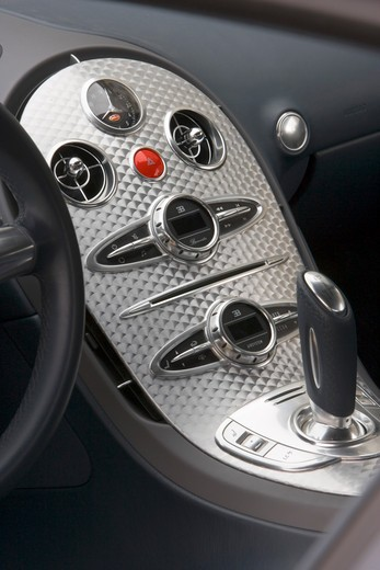 Stock Photo: 4093-16588 An interior detail view of a 2007 Bugatti Veyron. The Bugatti Veyron 16.4 is currently the fastest, most powerful, and most expensive street-legal full production car in the world, with a proven top speed of 253 mph (407.5 km/h), though several faster or more expensive vehicles have been produced on a limited basis.[1] It reached full production in September 2005. The car is built by Volkswagen AG subsidiary Bugatti Automobiles SAS in its Molsheim (Alsace, France) factory and is sold under the l