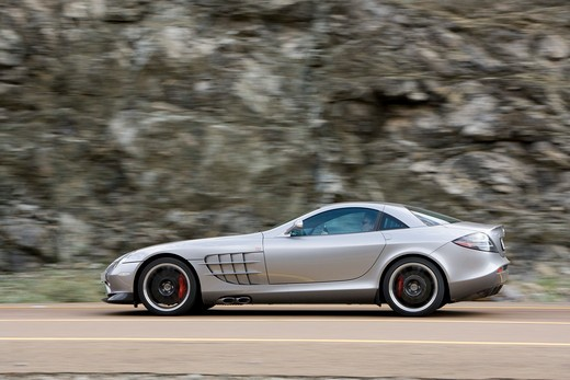An action shot of a 2007 Mercedes-Benz McLaren SLR 722. The 722 refers to the victory by Stirling Moss and his co-driver Denis Jenkinson in a Mercedes-Benz 300 SLR with the starting number 722 (indicating a start time of 7:22 a.m.) at the Mille Miglia in 1955. The 722 Edition creates 650 bhp, with a top speed of 337 km/h (5 more than the standard SLR). A new suspension is used with 19-inch light-alloy wheels, a stiffer damper configuration and 0.4 inches lower body. The SLR is planned to end pro : Stock Photo