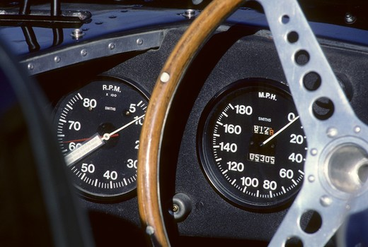 Stock Photo: 4093-16680 1955 Jaguar XK D-type interior detail gauges. Specifically showing the speedometer and tachometer. The Jaguar D type, like its predecessor was a factory-built race car. Although it shared the basic straight-6 XK engine design (uprated to 3.8 litres) with its predecessor, the majority of the car was radically different. Perhaps its most ground-breaking innovation was the introduction of a monocoque chassis, which not only introduced aircraft-style engineering to competition car design, but also a