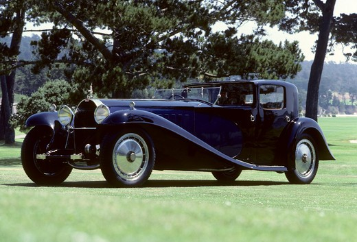 Bugatti Royale Type 41 front 3/4 beauty. The Bugatti Type 41, better known as the Royale, is one of the most extreme luxury cars ever built. It was enormous, with a 4300 mm (169.3 in) wheelbase and 6.4 m (21 ft) overall length. It weighed approximately 3175 kg (7000 lb) and used a massive 12.7 L (12763 cc/778 in¬?) straight-8. All six production Royales still exist (the prototype was sadly destroyed in an accident in 1931), and each wears a different body, some having been rebodied several times : Stock Photo