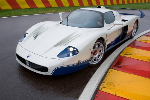 2007 Maserati MC 12 The Maserati MC12 is a grand tourer produced by Maserati to allow a racing variant to compete in the FIA GT Championship.  MC12 is a two-door coupe with a targa top roof on a closed track : Stock Photo
